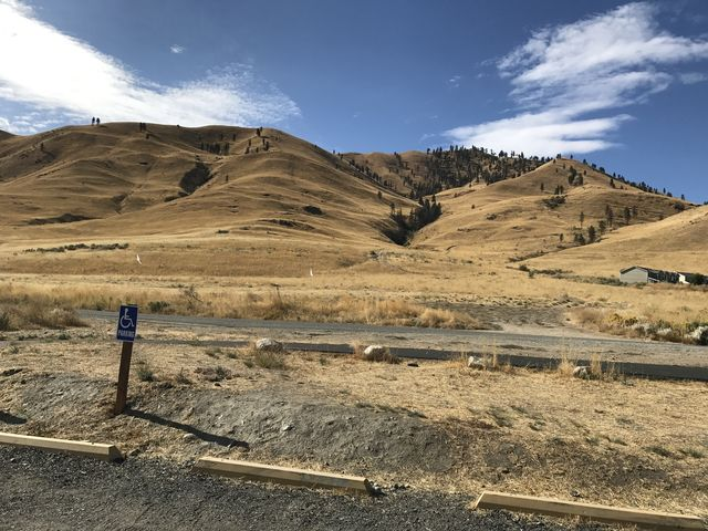 The trail starts on the far side of the road. Chelan Butte is to the right