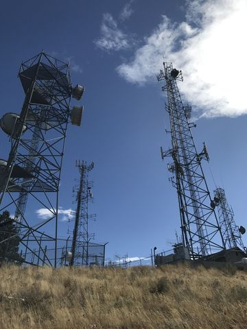 The butte is covered with antennas and towers. There is also a gravel access road, if driving is more your thing…