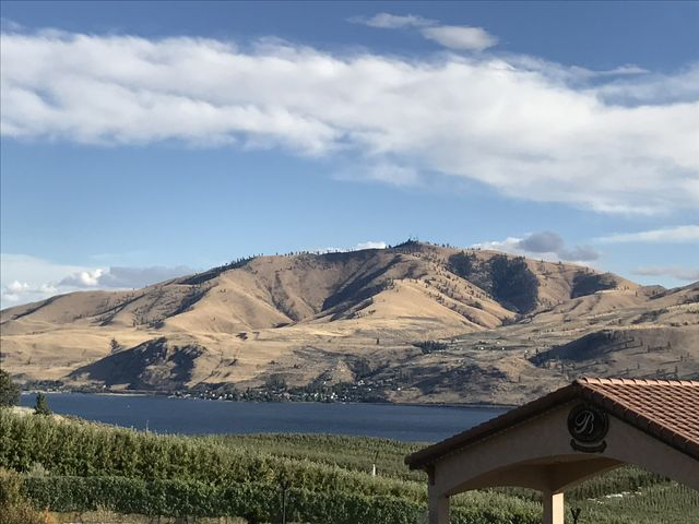 Chelan Butte, taken from the north side of Lake Chelan (Benson Vineyards to be exact; nice Syrah)
