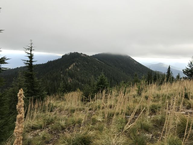 The clouds nipping at Pond Peak in the distance