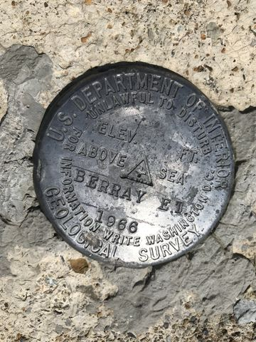 USGS marker. That would be 6,177 ft according to the USGS maps. 6,196 on the tower