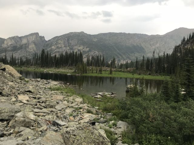 Little Ibex Lake in the foreground; in the background is Scotty Peak to the left and Snowshoe Peak to the right