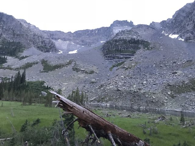 Little Ibex Lake and its meadow in the foreground, and the Ibex headwall in the background (Ibex Peak to the right)
