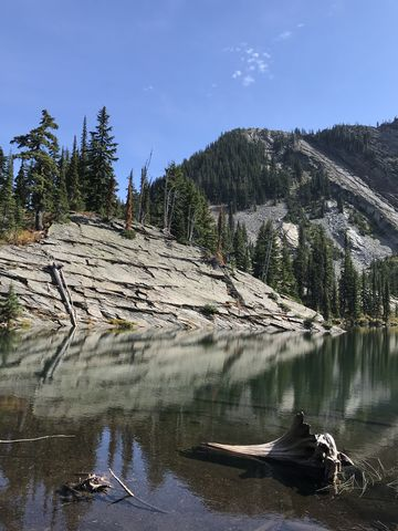 A sheer granite slab disappering into Upper Wanless Lake #2